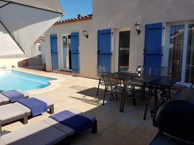 Photo for Cottage close to beaches with pool www.villapetitreve.fr