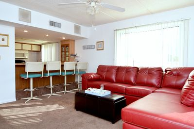 Enjoy casual dining at the counter, or relax on the sectional sofa.