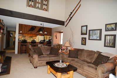 Spacious open living area with wood burning fireplace.