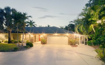 Photo for Waterfront - River, large pool, close to the beach - house with flair!
