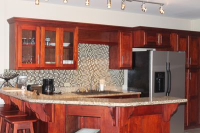 Kitchen area fully equipped with appliances.