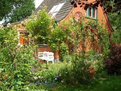 Photo for charming and cozy 4-star cottage with a romantic garden near the river