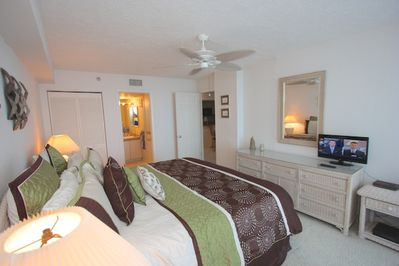 Unwind after a fun day at The Beach in this Spacious Master Bedroom with King Bed, Flat Screen TV, and Private Master Bathroom