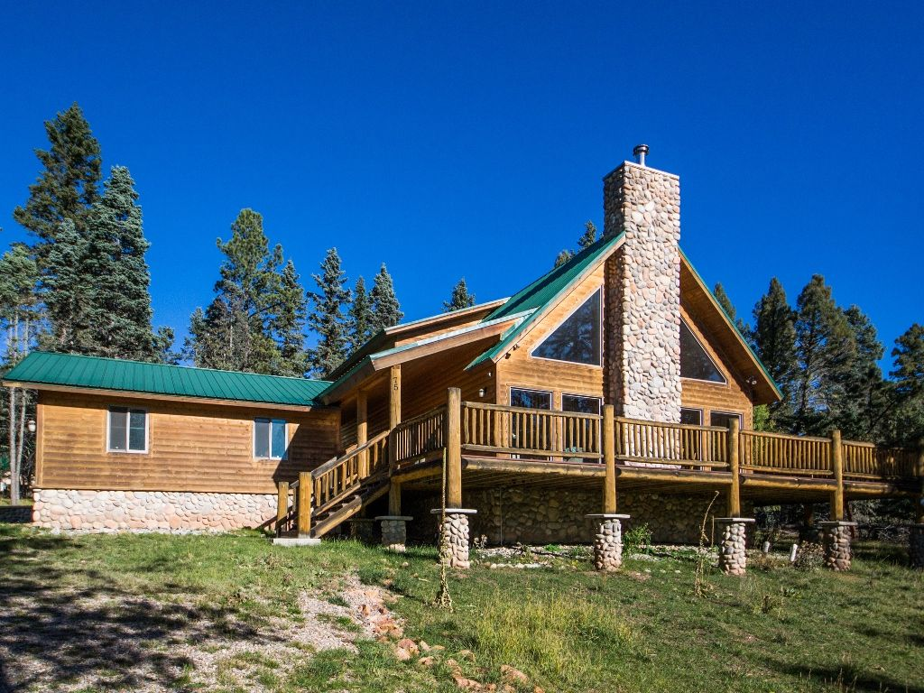 com house property of gallery hotel rainbow image angel home vacation cabins fire nm this booking us