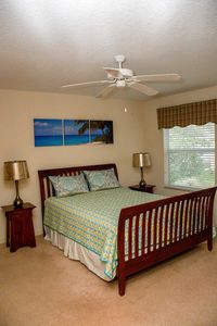 Master Bedroom, queen bed, man's chest, dresser and HDTV