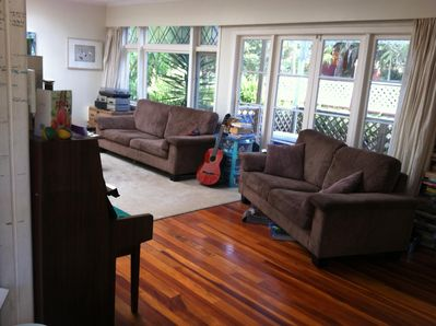 Open plan lounge with piano and guitar, large tv and many board games.