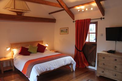 Cosy beamed bedroom with king size bed.