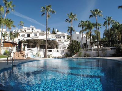 Photo for Nerja - Private terrace with sea and mountain views and pools