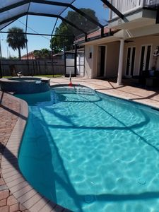 Photo for NAPLES FL 5 bdrm 6 bath pool home less than a mile from Naples beaches!