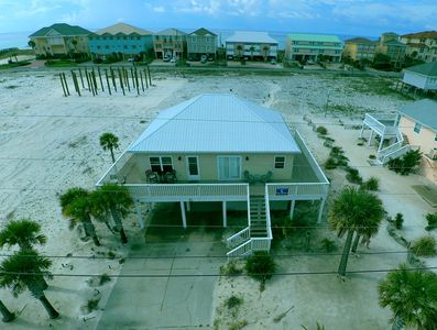 The gulf and beach are just steps from the back of the house