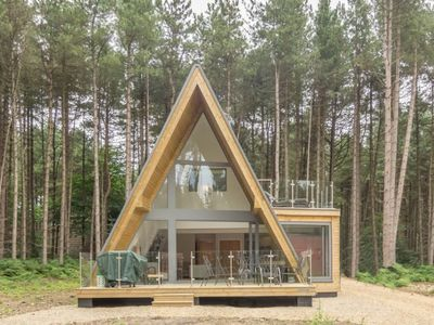 Photo for Get back to nature in style at this elegant and peaceful woodland retreat