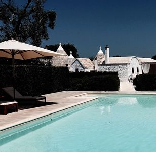 Photo for Elegant trullo with a large park and swimming pool. Ancient and modern harmony.