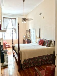 King Rice Bed in Magnificent bedroom w/fireplace & 14 foot windows on Broad St.
