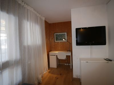 Photo for Nice studio for 2 people. Living room with sofa bed (2 persons), TV. Open kitchen with 4 ceramic hob