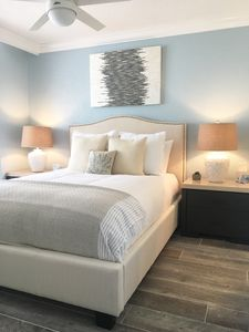 Master Bedroom w/ ceiling fan, blue tooth speaker & a device charging station