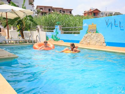 Photo for Grand Family Apartment with Wi-Fi and Swimming Pool, close to the Sea