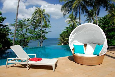 Dedon chair by the pool