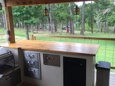 Outdoor kitchen and the lake!