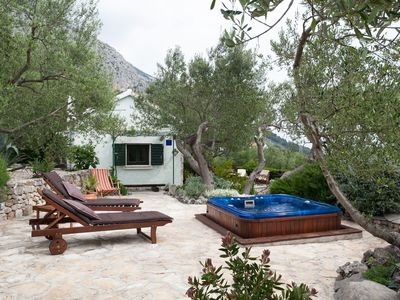 Photo for ctma141/ Lovely holiday house is located in a secluded place, surrounded by olive trees and greenery and is perfect for a family of 2-4 people
