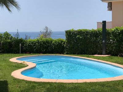 Photo for Apartment in villa with swimming pool and garden overlooking the sea on two levels