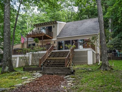 Photo for Bearfoot Lodge: Lakefront charmer with private dock & hot tub