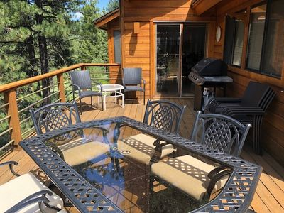Bear Lodge at Northstar - a SkyRun North Tahoe Property - Deck  - Wrap around deck off living and kitchen area. Nestled in the pines with view of golf course. Equipped with BBQ (year round), dining table and lounge chairs during summer months.