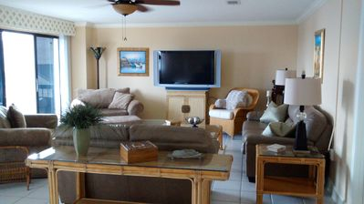 Can't you see yourself relaxing here! Large, comfy furniture. See the beach!
