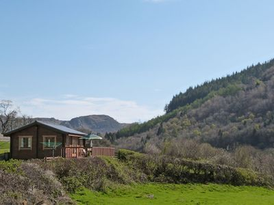 Photo for Wonderful views of mountain, fields and woodland await guests at this lovely, cosy wood cabin set on