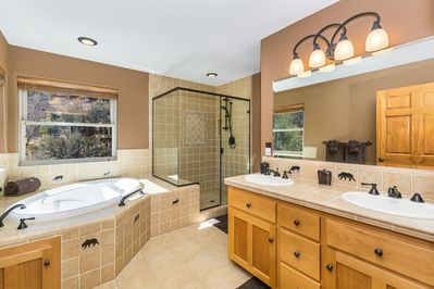 Relax in the large soaking tub or large glass incased shower