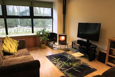 The sitting room has a cosy wood burning stove