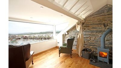Photo for Self-catering penthouse in harbour with stunning mountain view