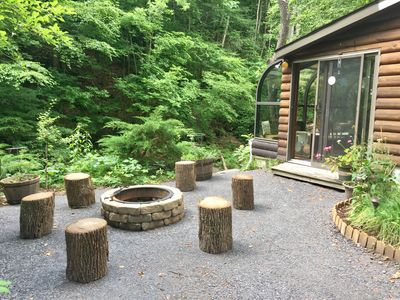Fire pit is just outside of the sunroom.