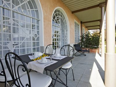 Photo for Wonderful apartment in a renowned art nouveau villa with pool and dream view
