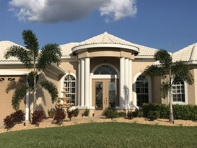 Photo for Coral Dreams - 3b/2ba SW Cape Coral Home, solar and electric heated pool, Boat Dock with nice covere