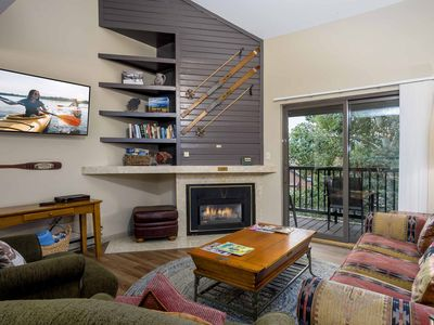 Photo for Family friendly roomy updated condo w/ access to pool, hot tubs & grill area!