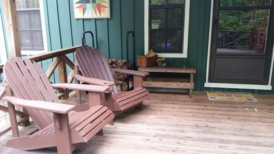 Front deck with adirondack seating and swing.