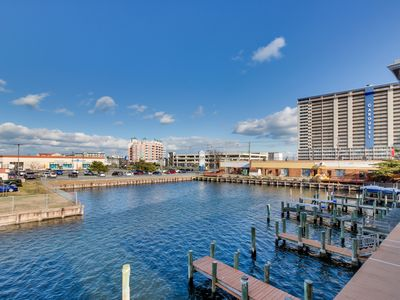 Photo for Gorgeous waterfront home w/shared pool - incredible for shopping, dining & more!