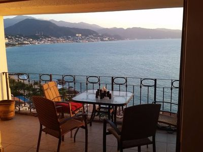 Photo for CORNER PENTHOUSE! Beachfront. Sunrises AND Sunsets. A/C. WiFi. Resort fees incl.
