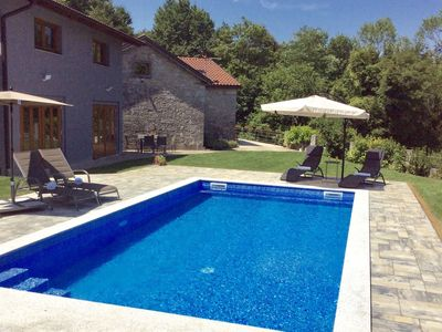 Photo for Spacious detached holiday home with garden, private swimming pool, on the edge of a forest