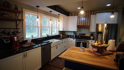 Farmhouse kitchen with updated appliances.