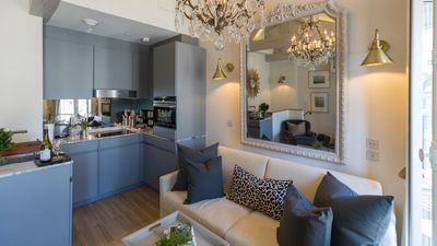 The open kitchen opens onto the living room creating an airy feel to the room