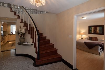 Entrance Foyer, stairs to second floor and partial view of Guest Bedroom #5