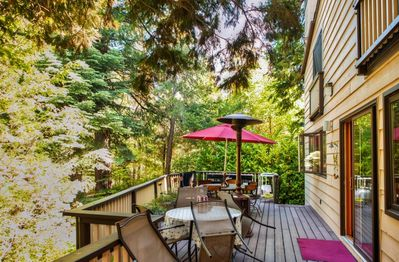Unwind on the deck and take in the incredible forested scenery