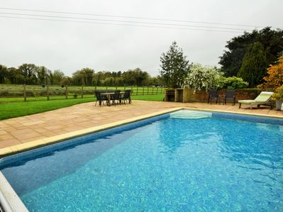 Private heated pool with countryside views