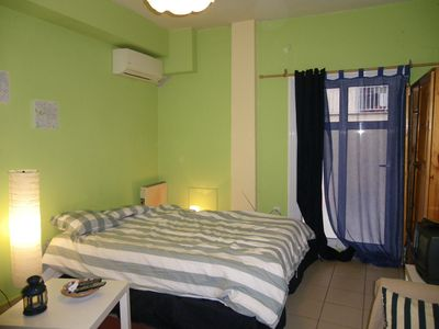 Angle of the studio with the double bed