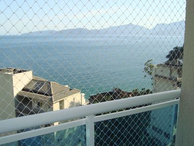 Photo for Apto Angra view of the sea in condominium with private beach and infra complete.