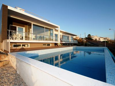 Photo for Majestic  - Villa with private pool and views over the sea and lagoon