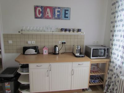 Kitchen includes microwave, toaster, coffee machine and dishwasher.