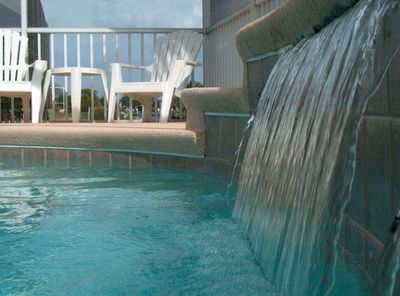 Enjoy the sunny South-facing waterfall pool!