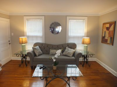 Spacious living room features lots of great decor